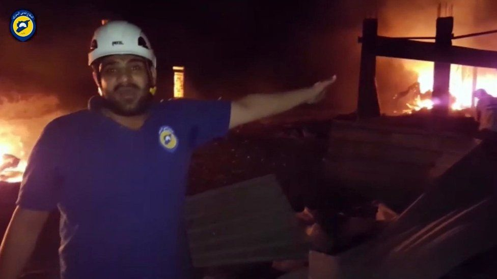In this grab taken from video provided by the Syrian Civil Defence White Helmets, a member of the team describes the damage after an airstrike, in Aleppo, Syria, on 19 September