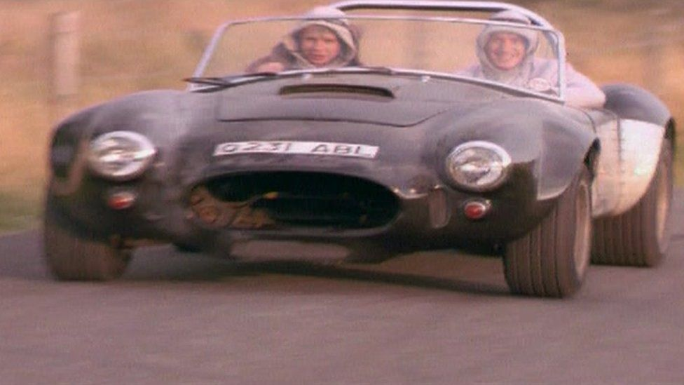 The Lewis twins driving an AC Cobra