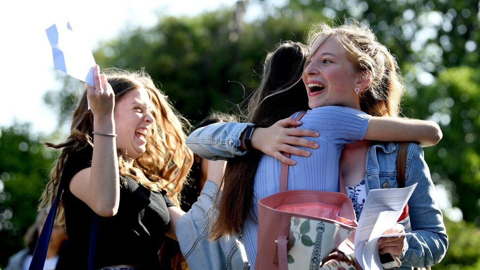Grace Murray (left) and Lucy Garside celebrate with their GCSE results at Norwich School in Norwich, Norfolk.