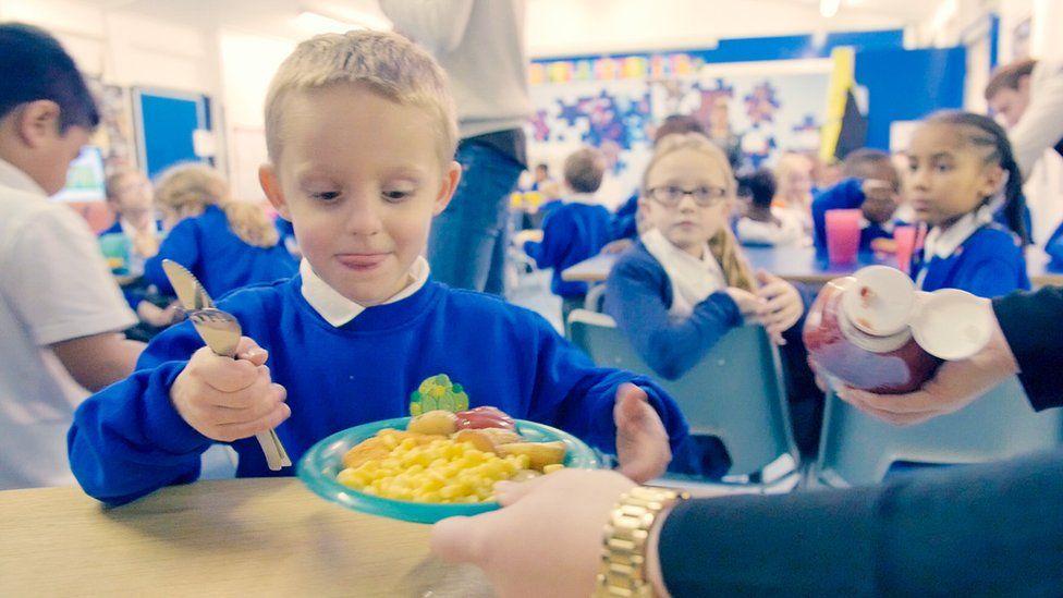 Schoolchildren having dinner