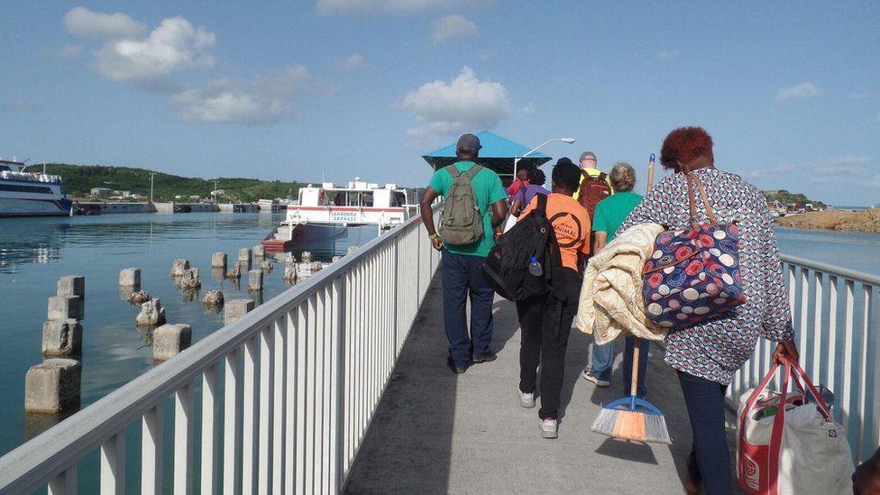 Barbudans board the boat home