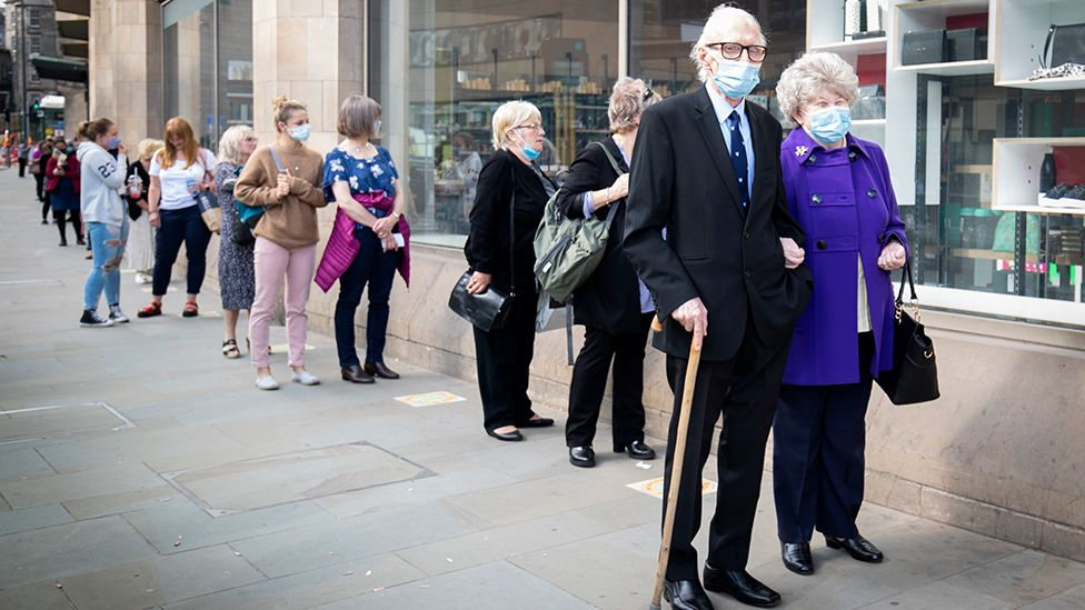 People queuing outside John Lewis in Edinburgh.