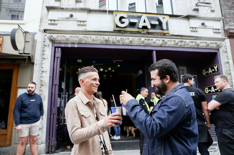 People gather outside G-A-Y, Old Compton Street, Soho, London. 4 July 2020