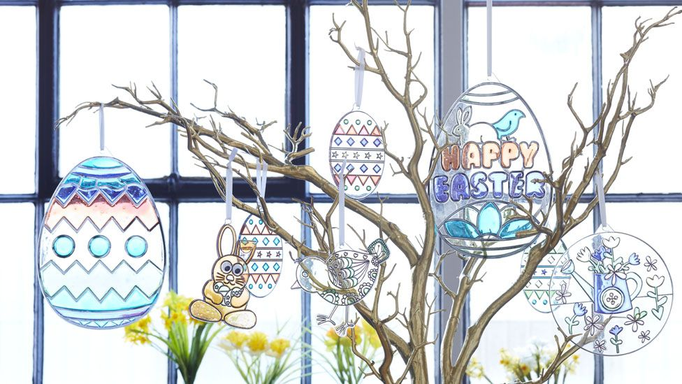 twigs with easter decorations hanging