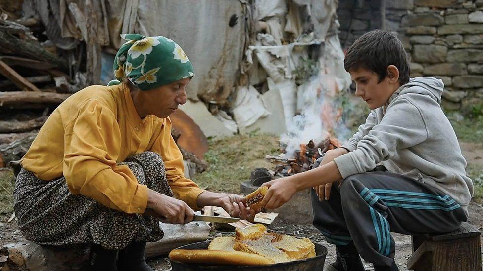 Hatidze shares honey with one of the Sam boys