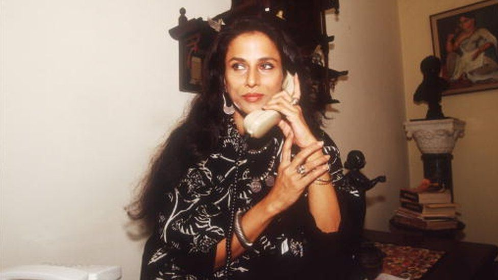 Indian author Shobha De speaks on the phone in her home February 4, 1993 in Bombay, I