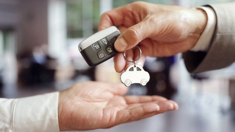 Men with car keys