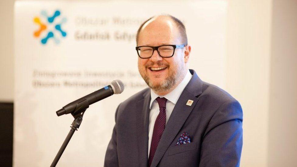"Gdansk""s Mayor Pawel Adamowicz smiles during a December meeting"