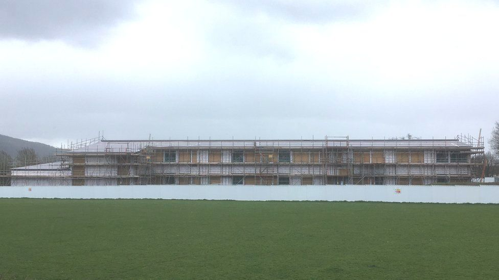 The primary school in Welshpool - the structure has been built and is surrounded by scaffolding