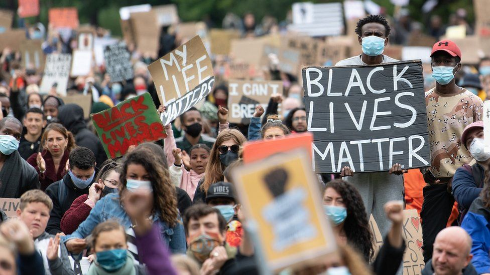 Protesters hold up placards in Cardiff