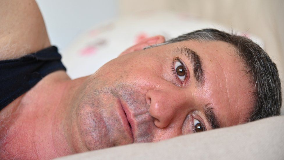 Middle aged man in bed