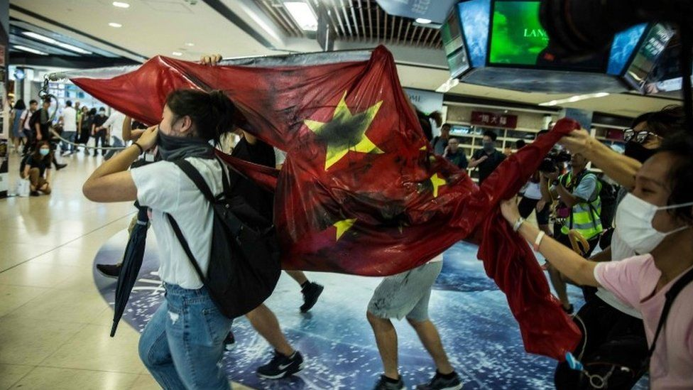 Hong Kong protests: China flag desecrated as fresh unrest erupts
