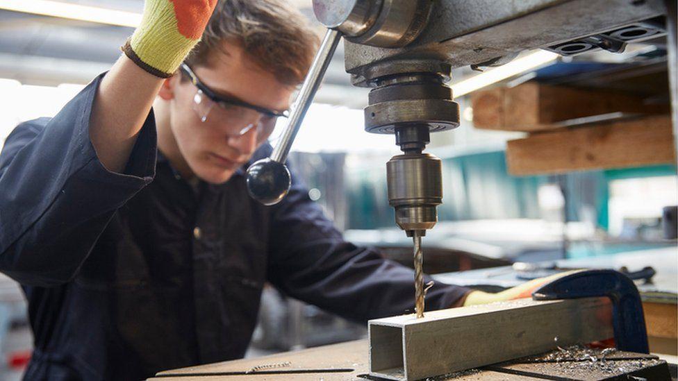 Apprentice using drill