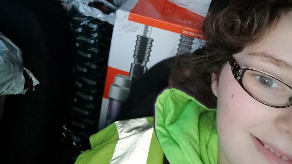 A photo of Sally in her van