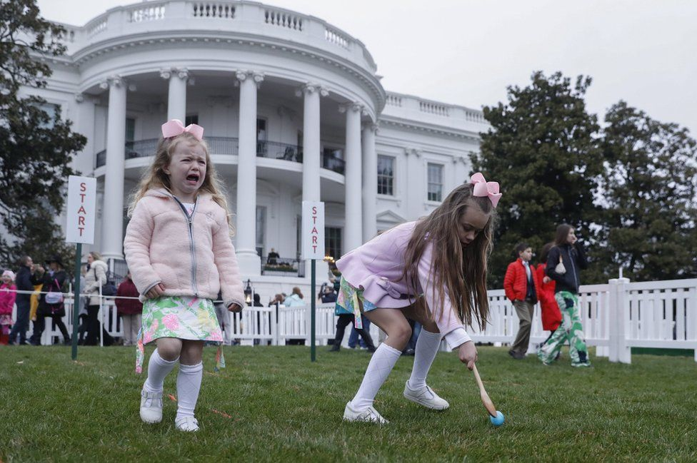 Victoria Ewers and her sister Elle Ewers participate in the 2018 White House Easter Egg Roll.