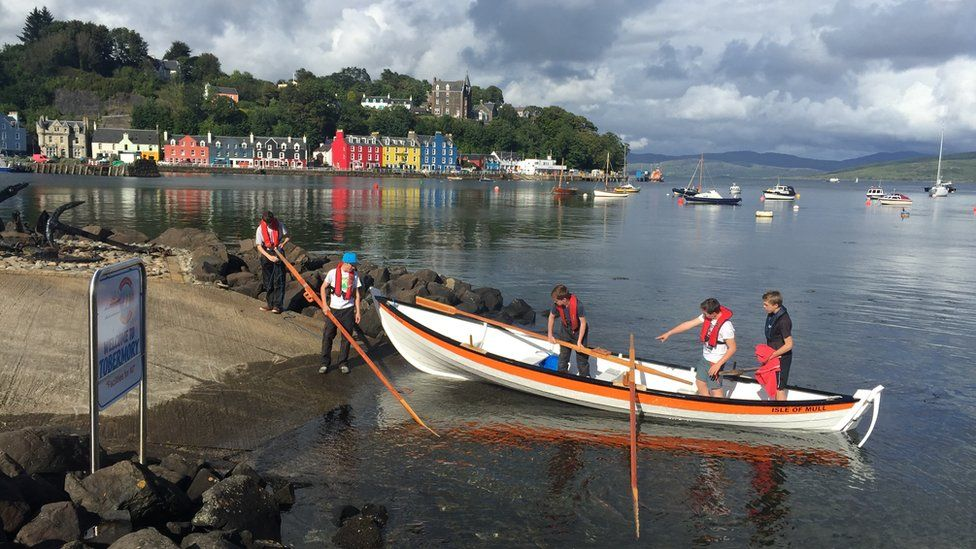 Some local young men taking their boat out in Tobermory