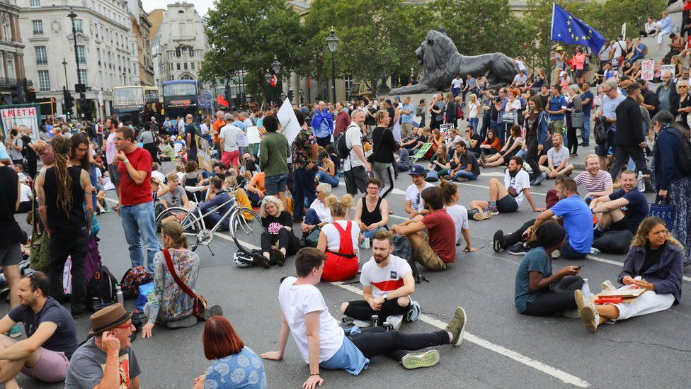 Anti Brexit protesters block the road and stop traffic in Trafalgar Square following a protest against Brexit and the prorogation of parliament in London,