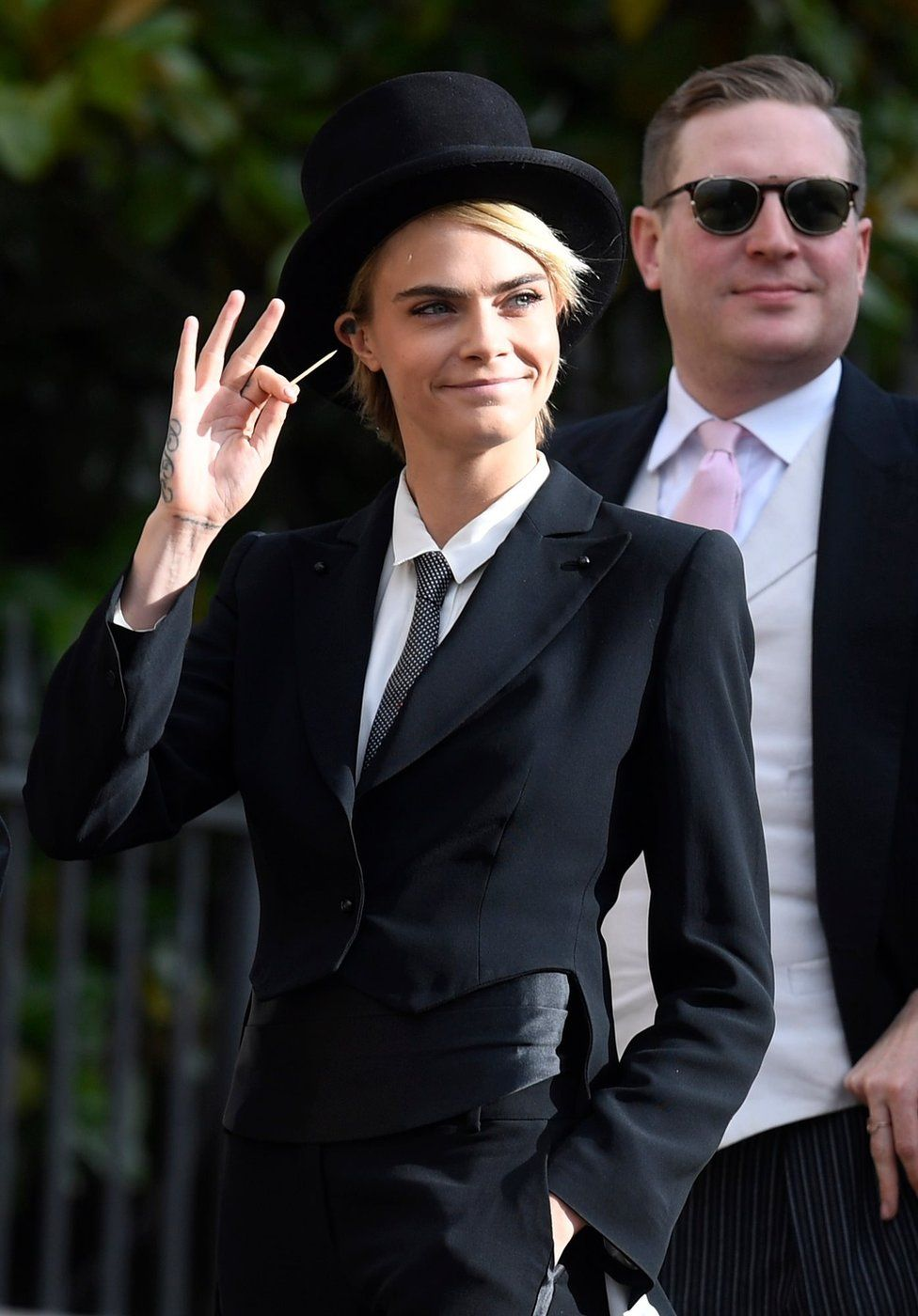 British model and actress Cara Delevingne arrives for the royal wedding ceremony