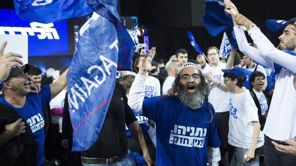 Likud supporters celebrate at the party's headquarters in Tel Aviv on 10 April 2019