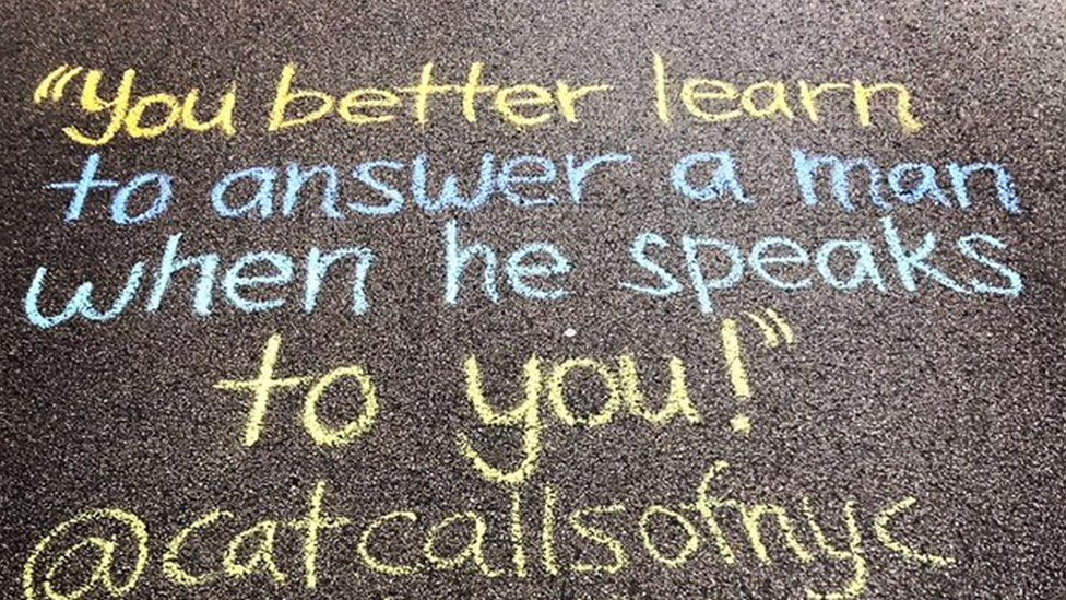 """A catcall reading: """"You better learn to answer a man when he speaks to you"""" written on the ground"""