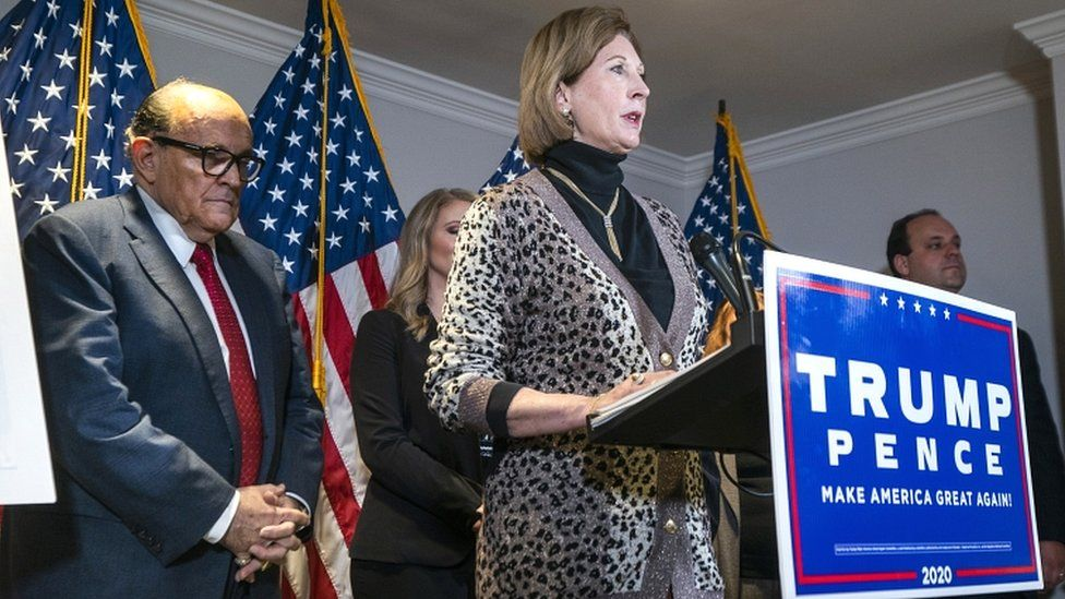 Attorney Sidney Powell (C), a member of US President Donald Trump's legal team, speaks alongside Trump lawyer and former mayor of New York City Rudy Giuliani (L) about the president's legal challenges to his election loss to President-elect Joe Biden in the Republican National Committee Headquarters in Washington, DC, USA, on 19 November 2020