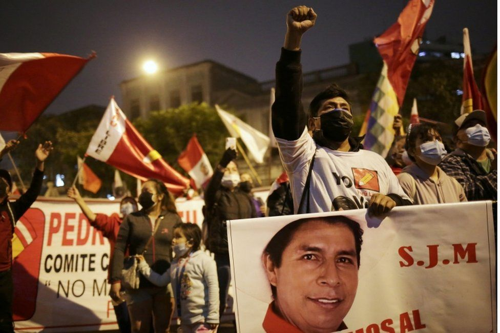 Supporters of Peru's presidential candidate Pedro Castillo gather on a street the day after a run-off election, in Lima, Peru June 7, 2021