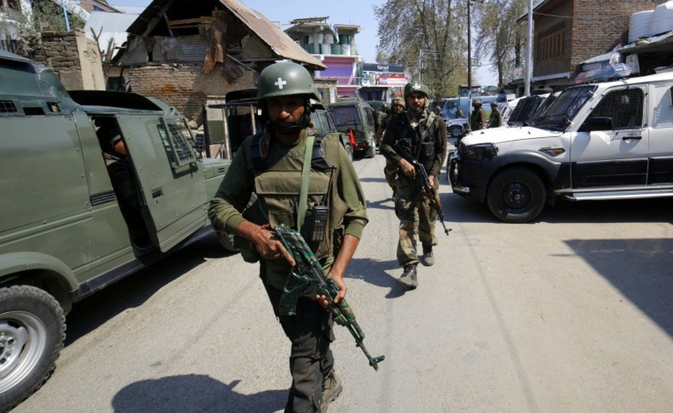 Indian army soldiers patrol during a gun fight with militants in Kachdoora, southern Kashmir