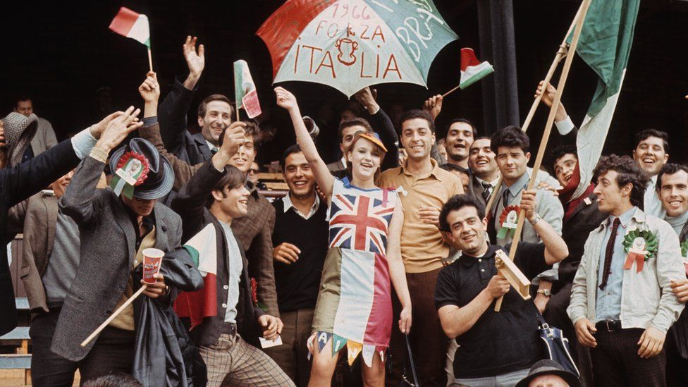 17-year-old Kathleen Riddel of Sunderland cheers on Italy with the help of some native Italian fans, as they took on the USSR at Roker Park