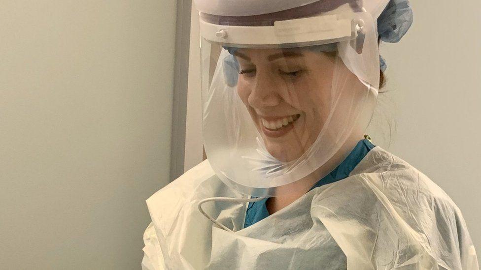 Sara Gering wears protective gear