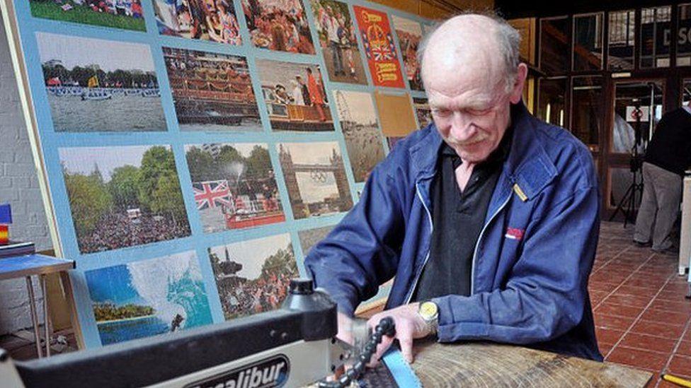 David Evans cutting jigsaw pieces