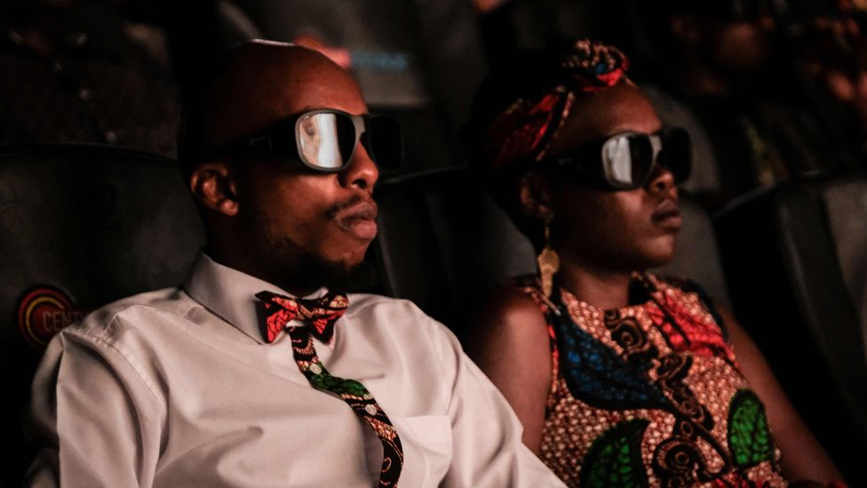 """Invited guests watch the film """"Black Panther"""" in 3D in Nairobi, Kenya, on February 14, 2018"""