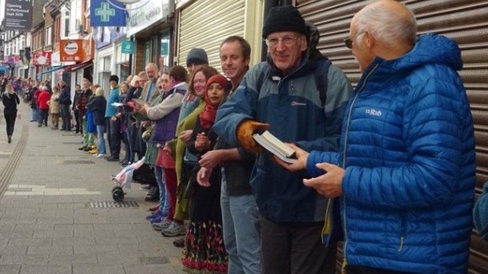 Human chain at October Books