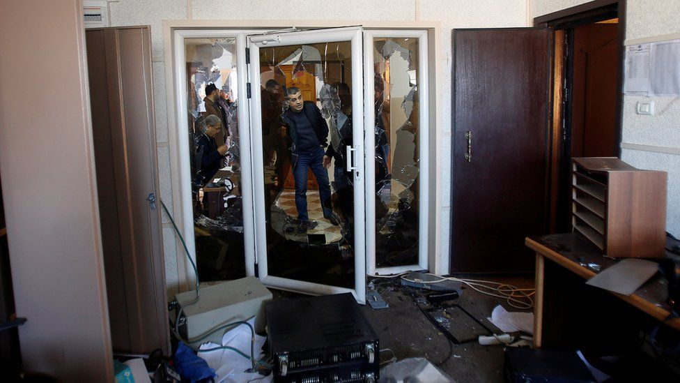 Palestinians inspect the damage inside the office of Palestine TV, in Gaza City January 4, 2019
