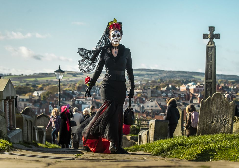 A costumed woman in a graveyard at the Whitby Goth Weekend