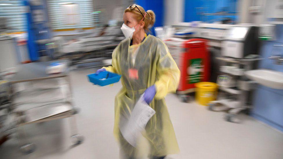 A nurse treats COVID-19 patients in Intensive Care Unit at Milton Keynes University Hospital