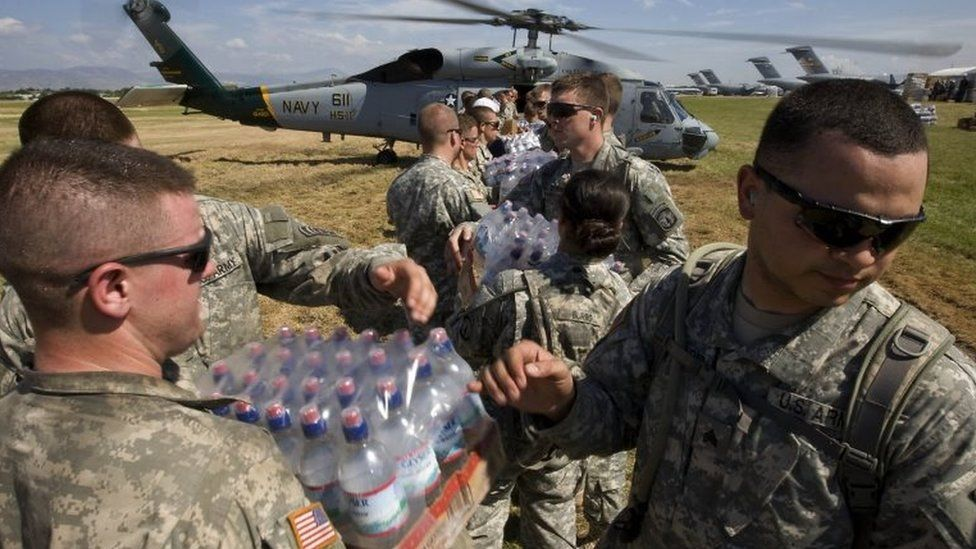 US soldiers load food and water onto a helicopter 20 January 2010 in Port-au-Prince, Haiti.