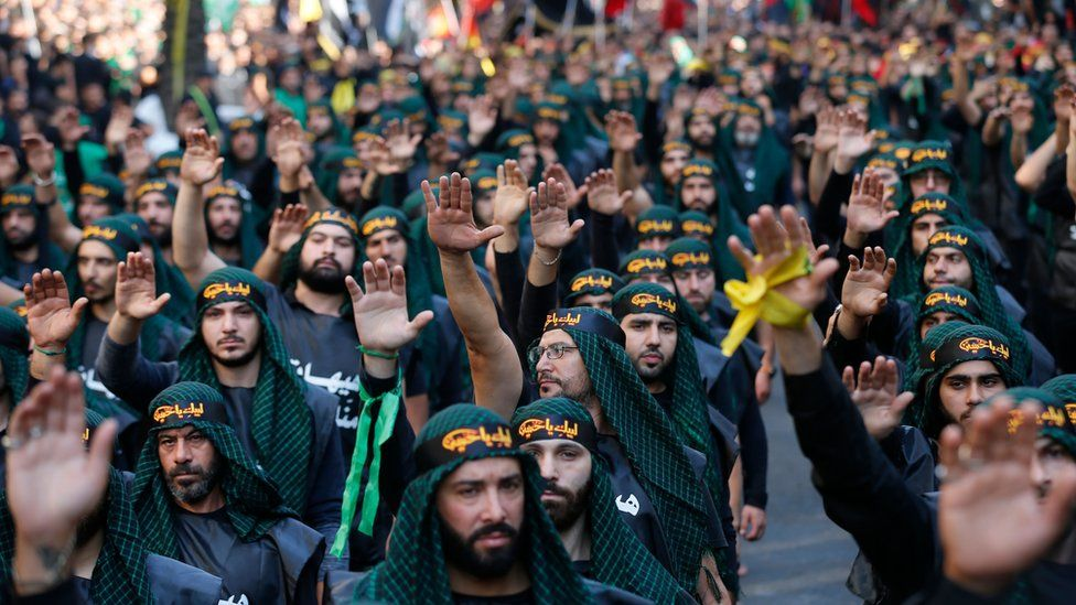 Supporters of Hezbollah take part in a parade to mark Ashura in Beirut on 20 September 2018