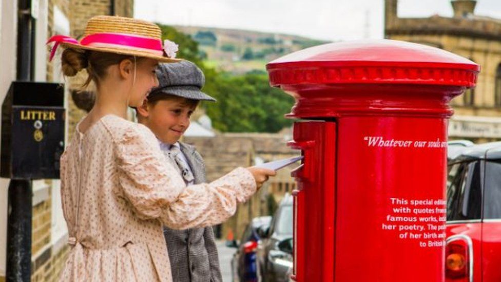 Children from Thornton Primary post letters in the Emily Bronte commemorative postbox