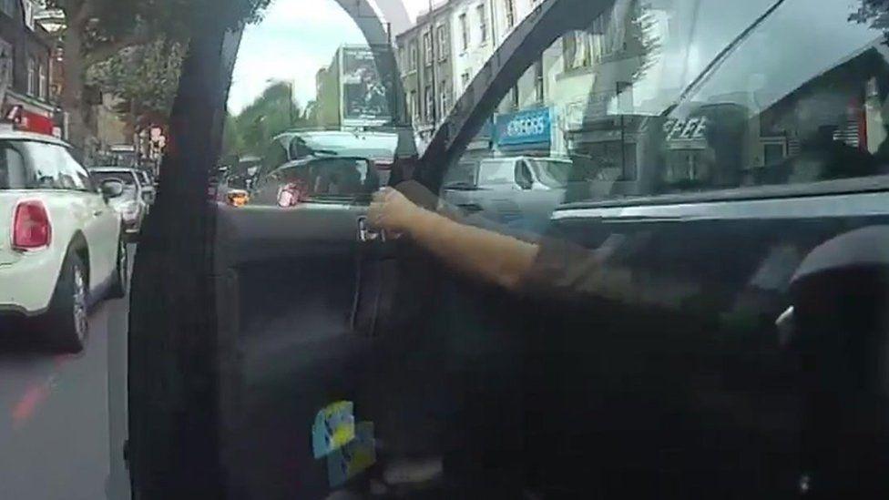 Person opening car door