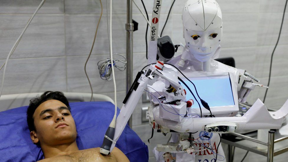 A volunteer is examined by Cira 3, a remote-controlled robot that runs tests on suspected coronavirus disease (COVID-19) patients to limit the human exposure to the virus, amid a second wave of infections in Tanta, Egypt, November 18, 2020. Picture taken November 18, 2020.