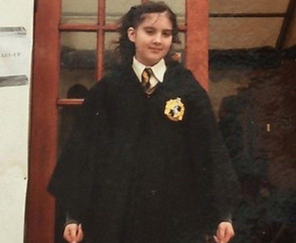 Verity Collins wearing a Hogwarts uniform