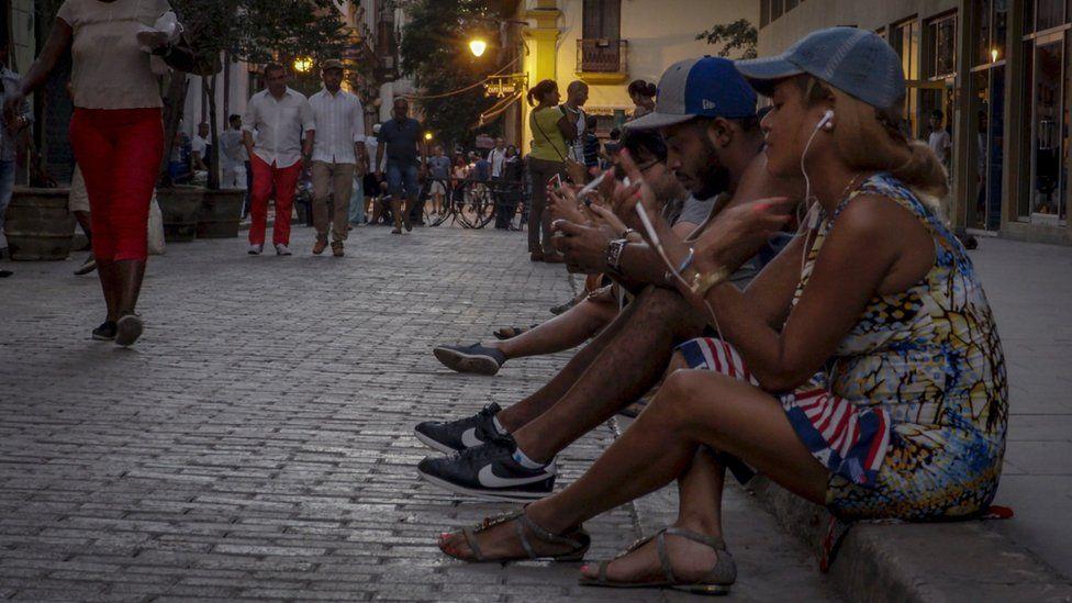 Cubans at a wi-fi hotspot
