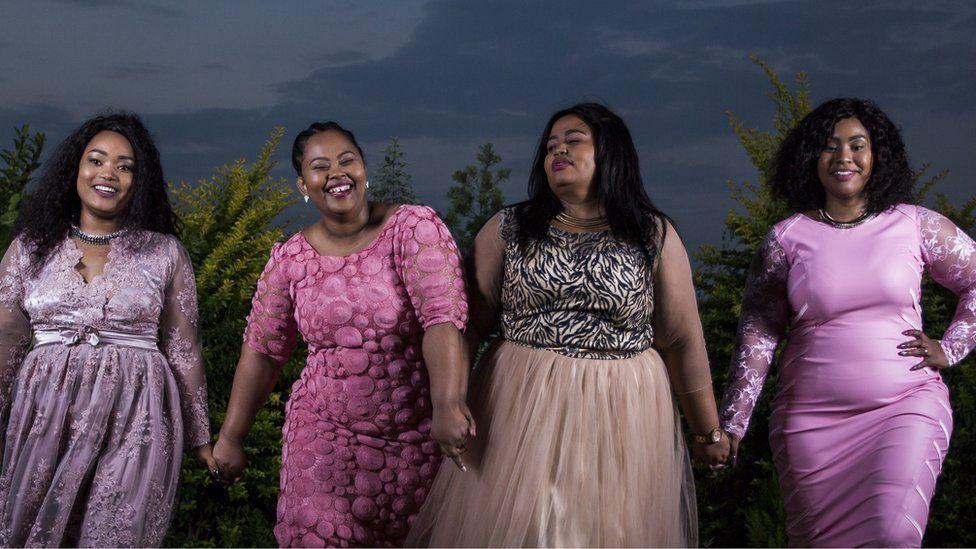 The four Mrs Mselekus holding hands.