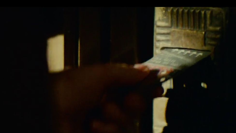 Deckard uses a key card to enter his home
