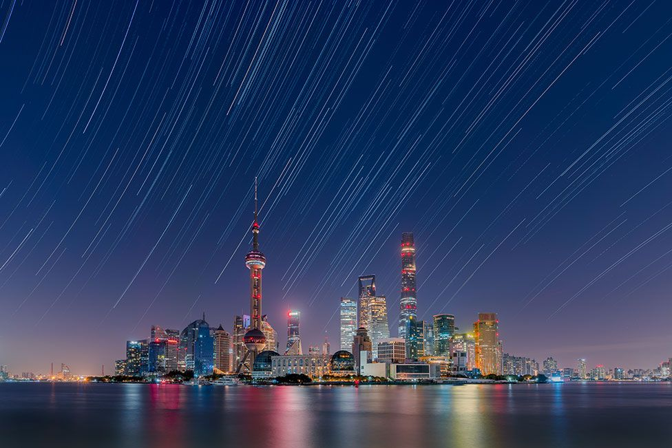 An image of stars over the Lujiazui City Skyline in China