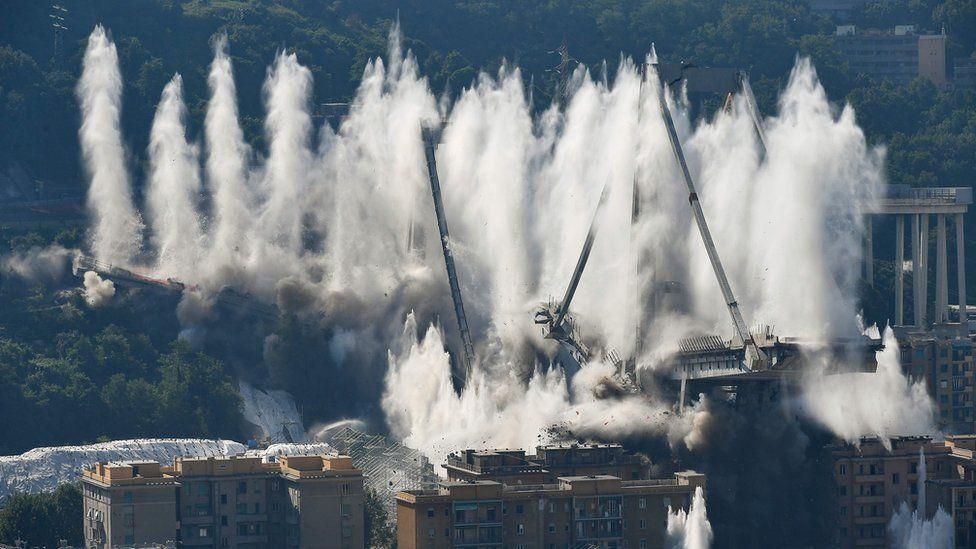 "Explosive charges blow up the eastern pylons of Genoa""s Morandi motorway bridge on June 28, 2019 in Genoa"