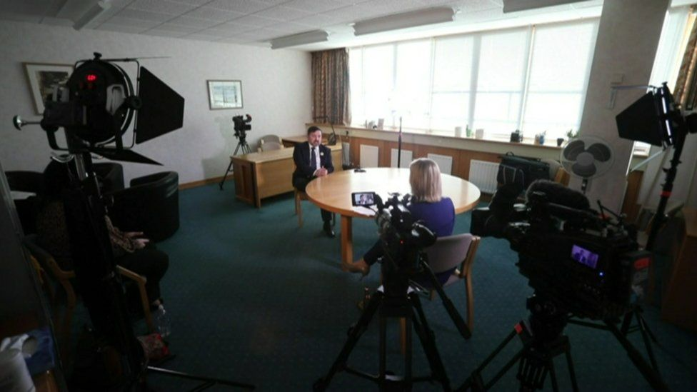 Health Minister Robin Swann being interviewed by BBC News NI health correspondent Marie-Louise Connolly