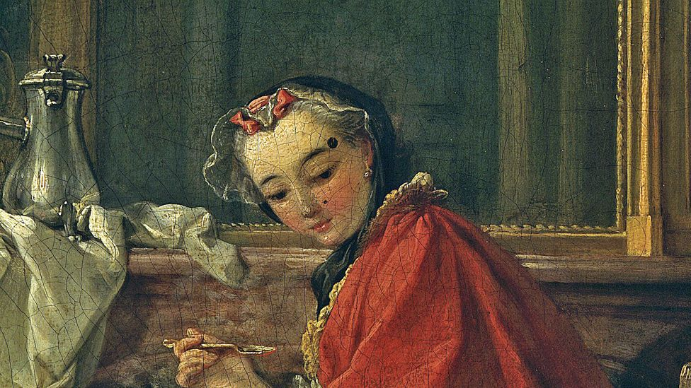 Detail from Le Dejeuner by Francois Boucher (1739) showing woman with prominent beauty mark above her eyebrow