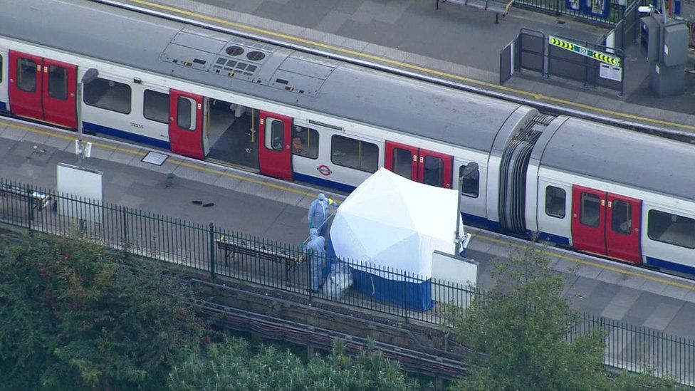 Tube train with forensic officers