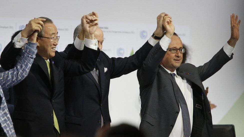 World leaders holding hands in jubilation